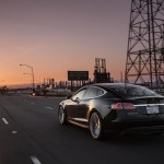 2012-Tesla-Model-S-rear-three-quarter-motionP