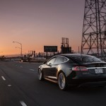 2012-Tesla-Model-S-rear-three-quarter-motionP